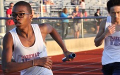Freshman Chris Bass races to victory