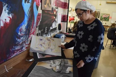 Senior Olivia Molino explains the art critique she attended at Washington University