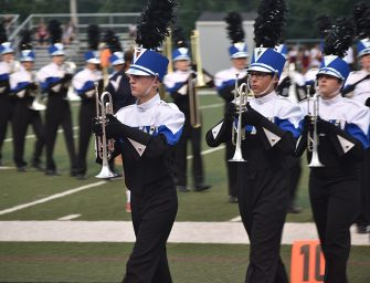 Marching band parades around school