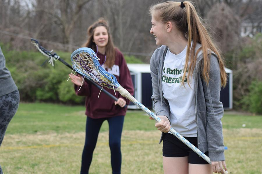 During C-team practice, freshman Ava Pfeil checks to see if anyone is open.