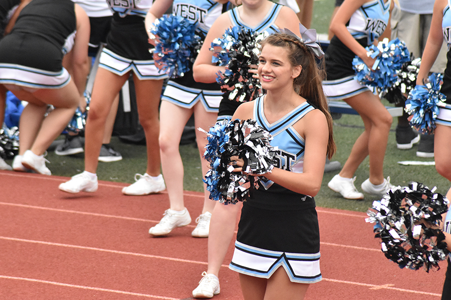 Kristen Baranski cheers for the football players alongside the rest of her team at a varsity game.