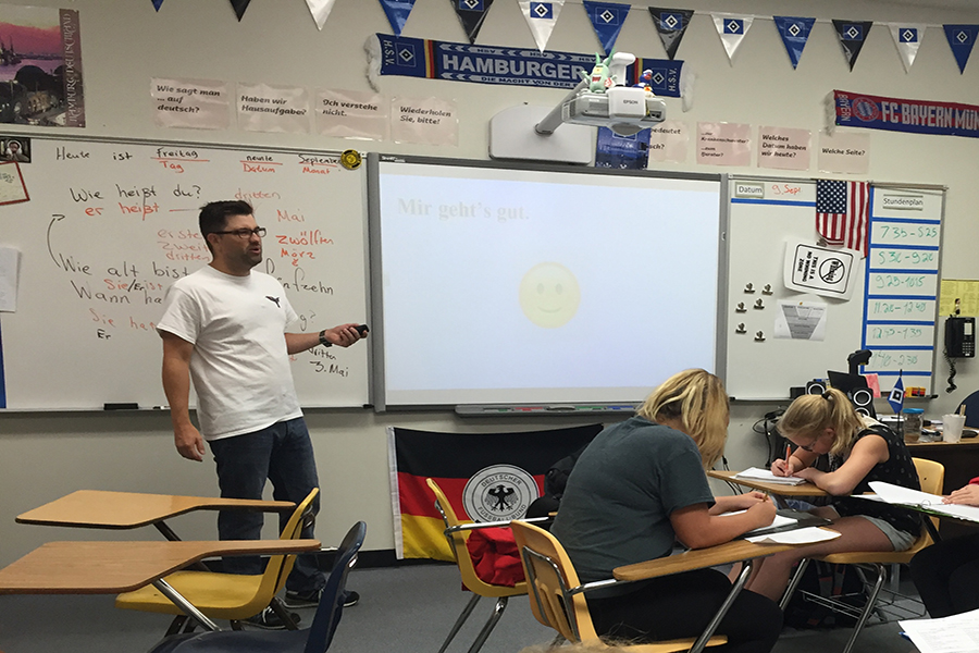 German+teacher+Michael+Kloster+teaches+his+first+hour+German+I+class+a+lesson+on+verb+conjugation.
