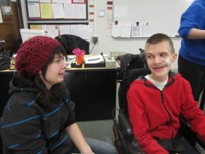Beginning Journalism reporter Adam Selms interviews freshman Alex Clayton during class.