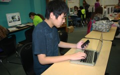 Bringing his own Mac to school, freshman Nick Chiu multitasks during class.  Chiu uses his own devise to take notes and work on class projects.