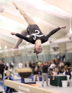 Senior Kelsey McClure flips to the top