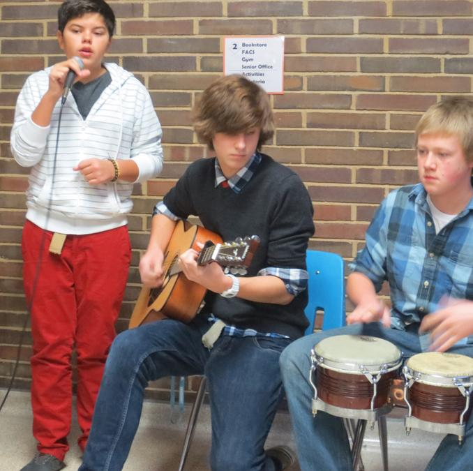 The morning of Friday, Dec. 14, the Fallen Kings play for a crowd at the top of the main stair well. The guitarist of the band, freshman Jacob Cupps played the song