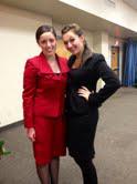 Senior Annie Schuver and Lauren Jones, from Belleville West High School, attend the Jay Jansen Debate Tournament.
