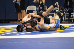 On November 28, senior Kyle Campbell pins an opponent from Seckman.