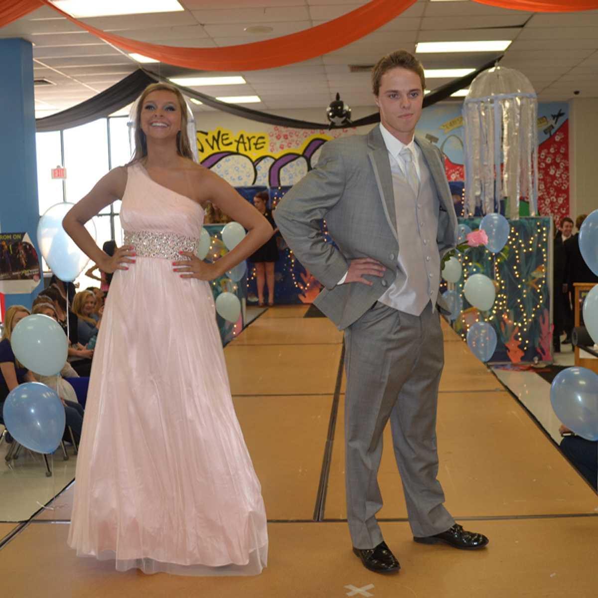 Seniors Kelly Popelar and Ryan Demuri pose together at the fashion show.