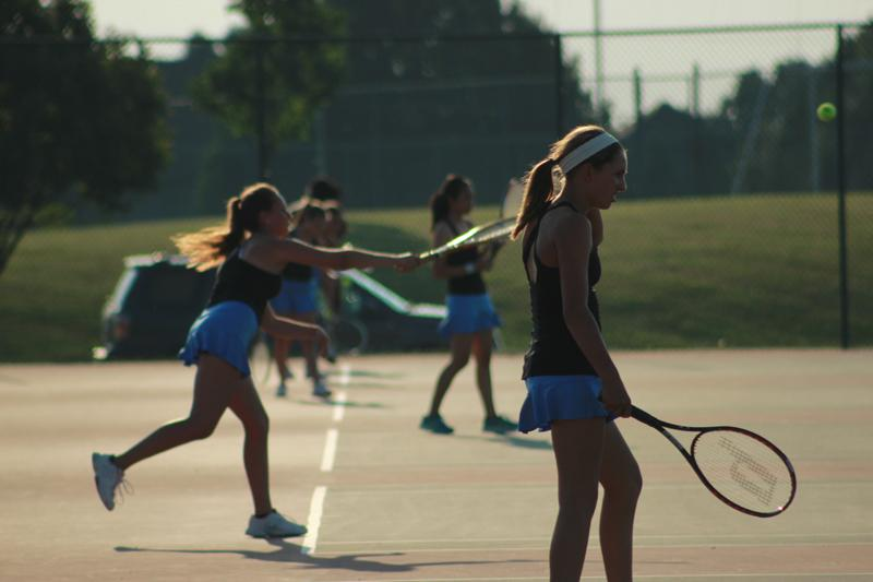 The girls tennis team takes the courts Fri. Aug. 23 at Red and Blue Night. The team had been practicing for two weeks prior to the event.