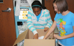 Community Outreach at West (COW) gathered a total of 863 items to help the tornado victims in Oklahoma in a matter of four days. Sophomores Danielle Emanuel and Zoe Goff counted donation items.