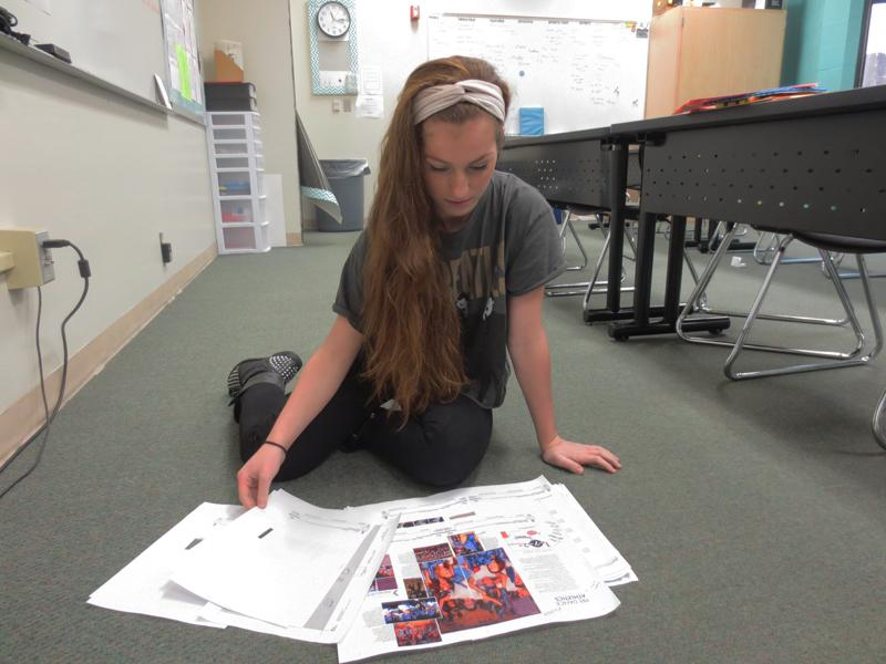 """The Paweshi 2012-2013 yearbook received the First Class Honor Rating in the National Schoclastic Press Association critique. The book received two marks of distinction in coverage and writing/editing. Editor in-Chief senior Megan Reilly works on the 2014 yearbook. """"This year I'm going for a more sophisticated look,"""" Reilly said."""