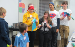 High School Heroes Hasan Baig and Jacob Cupps look on as sixth graders participate in an activity to demonstrate the harmful effects of marijuana.