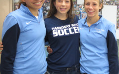 The Rath sisters pose at a team breakfast in Coach Wayland's room.