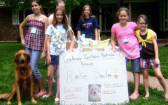 Egan (second from right) at age 10 raised $126 during her first year at the bake sale.