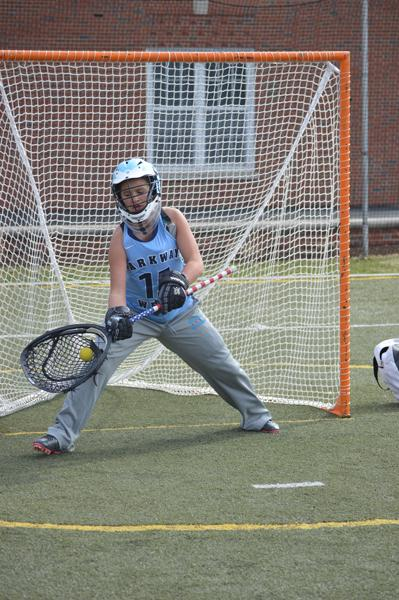 "Sophomore Tabatha Saake saves a goal during the varsity lacrosse game. Saake is being awarded the 1st Team All Conference award for the position of goalie. ""When I started playing last year as a freshman, I fell in love with the sport. One of my favorite things about lacrosse is bonding with my teammates through our love of lacrosse and the hard work we all put out,"" Saake said."
