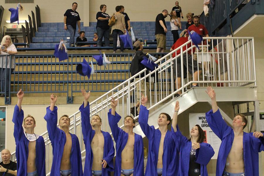 Seniors+Ryan+Schlueter%2C+Grant+Keesling%2C+Chandler+Klemm%2C+Nicholas+Klemm%2C+Joshua+Emde+Hillie+Hedgecock+and+Eli+Harris+throw+their+caps+at+their+%22graduation+ceremony%22+at+the+St.+Peters+Rec+Plex+after+the+state+championship+game.