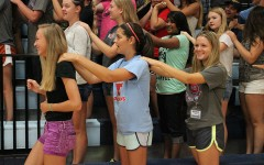 Freshmen Claire Goedde, Caroline Shaw and junior Rachel Ebner give each other back massages as part of New Student Orientation.