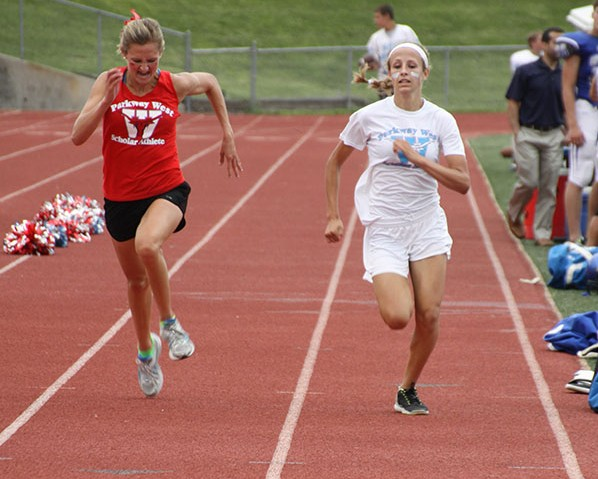 Senior Maddy Brown and sophomore Natalie Rath sprint toward the finish of the 2.2 mile race at Red & Blue night on Aug. 15.