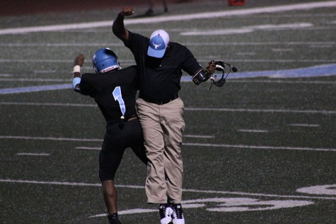 Junior running back Nick Lewis celebrates with assistant coach Melvin Bethany after a touchdown.