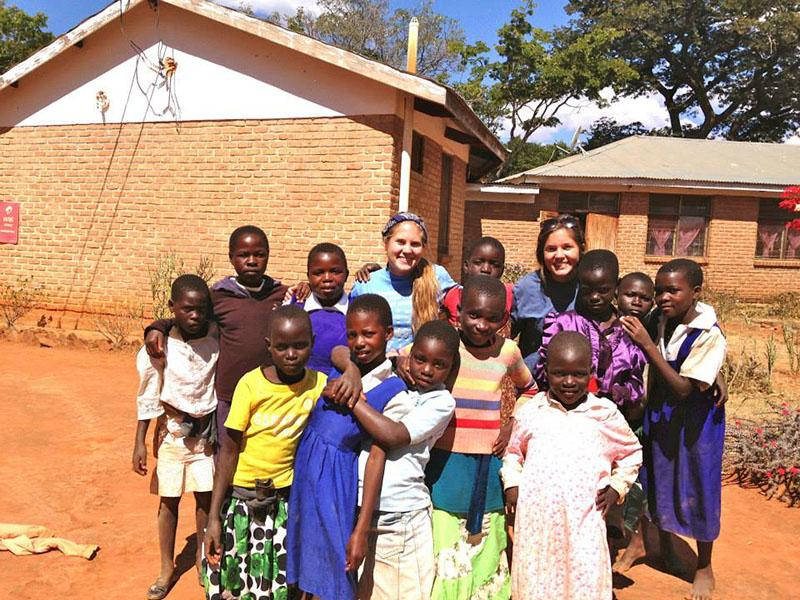 Junior Gwenn Pietrowski and her sister Erin travel to Embangweni, Malawi with family.
