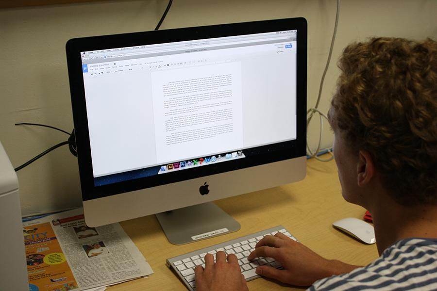 Junior Noah Andrews  uses Google Drive for a short story essay in Erin Fluchel's English III class.