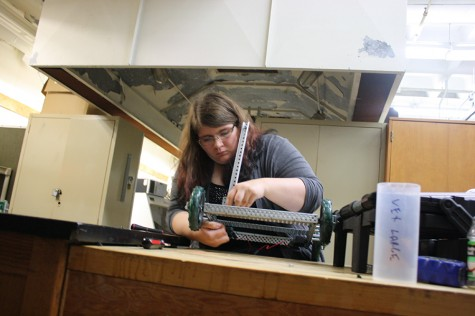 Senior Onika Martin works on her team's robot for the Oct. 24 contest.
