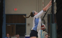 Defending the net, freshman Colleen Smith blocks her opponents spike in a game against Lindbergh.