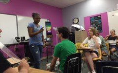 Freshman Gabby Thompson and Graham Chamber-Wall act out a scene in To Kill a Mockingbird.
