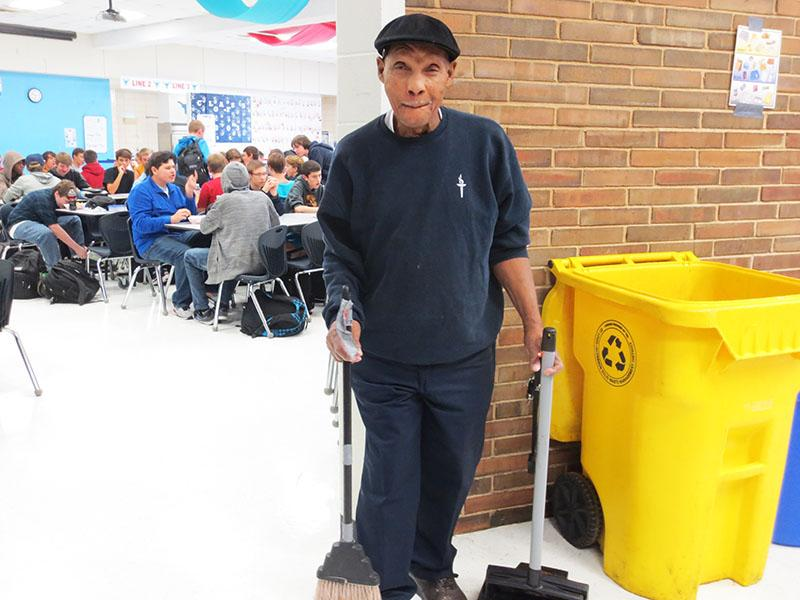 During second lunch, Custodial staff member Ollie Caruthers sweeps the floor.
