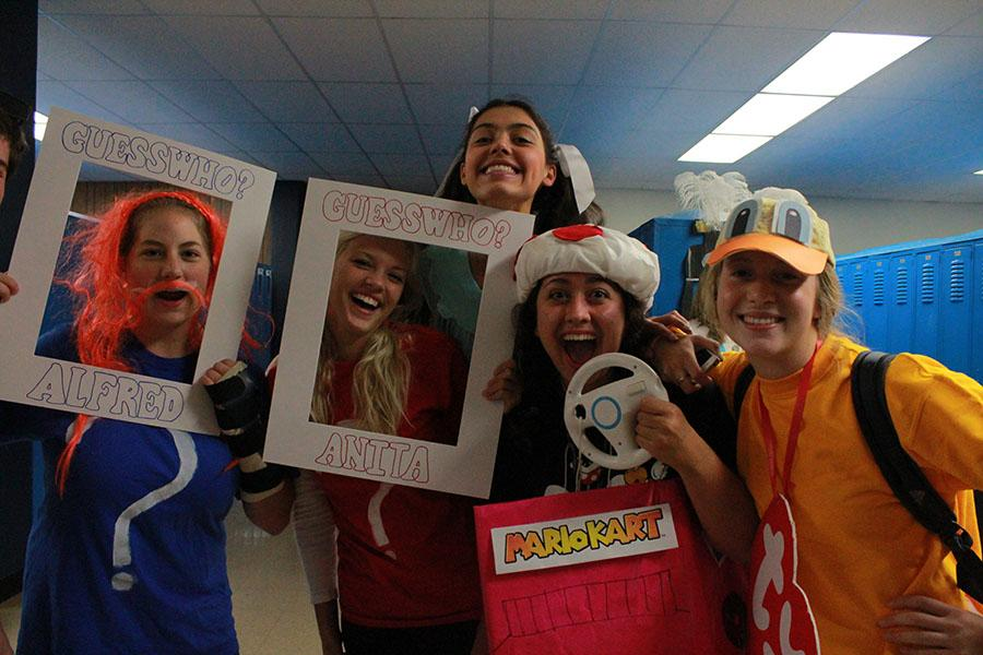Seniors Claire Webster, Olivia DiCampo, Stefanie Elsperman, Ela Sutcu and Natalie Friese dress up for Toys and Games day.