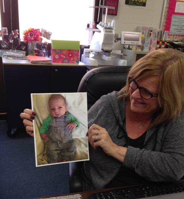 FACS+teacher%2C+Renee+Broemmelsick+looks+at+a+picture+of+her+new+grandson.+
