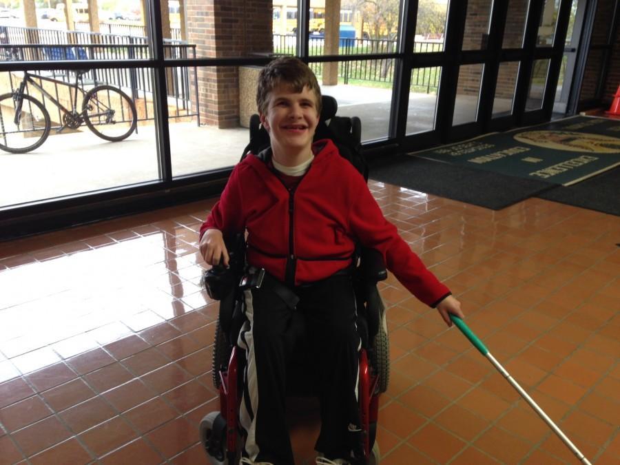 Senior+Adam+Selm+helps+clean+the+floor.