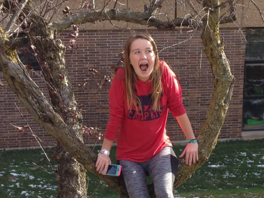 Freshman Jane Fuller goofs around in a tree despite the cold weather.