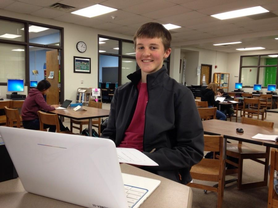 Working on a research project, freshman Joe Roseman uses a Chromebook in the library.