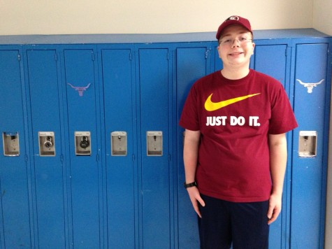 Junior Holt Priest stands along the science hallway lockers.