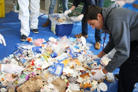 Junior Milan Malhotra sorts through the trash that had been thrown in the recycling bin.