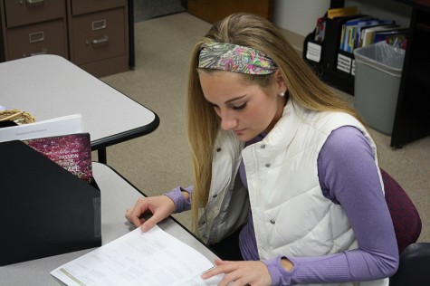 Madeline Kaempfe looks through a college pamphlet.