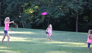 Sydney Veltman playing with her foster siblings Autumn Angus and Summer Buckner.