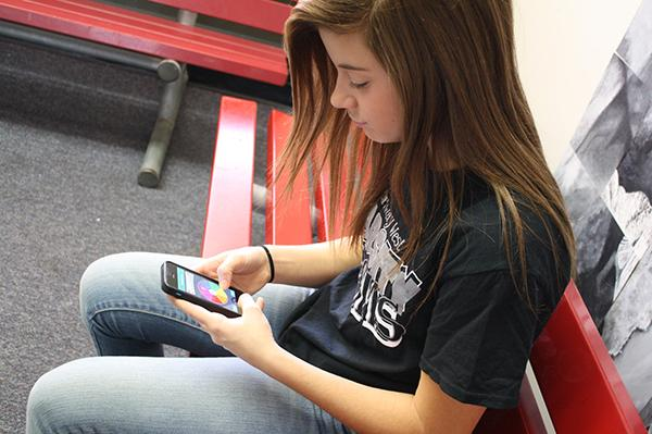 Student Kennedy Silverberg takes a break from studying  to play Trivia crack .