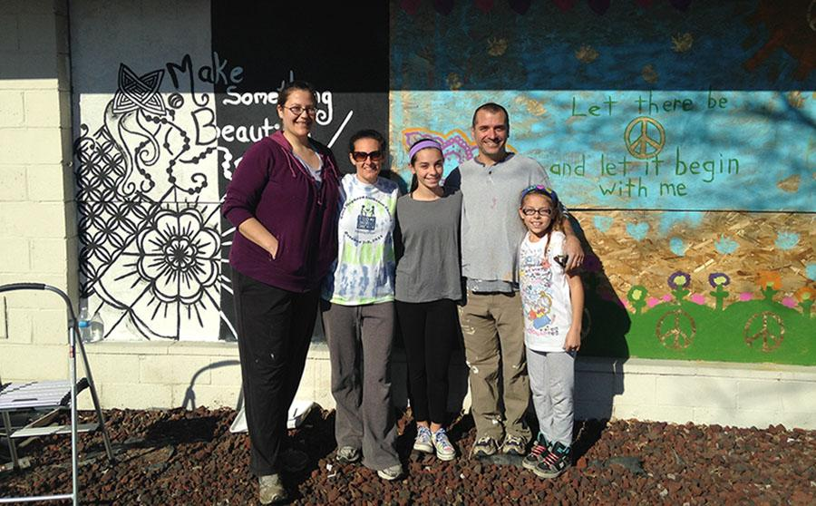 Chistina Neuwirth, Laura Neuwirth, Kayln Neuwirth-Deutsch, Blaine Deutsch and Julia Neuwirth-Deutsch spend a day in Ferguson brightening up the community as they painted four boarded up windows over Thanksgiving break.