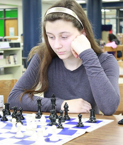 Sophomore Liza Tarakanova concentrates on making her next move in a game of chess at the club.