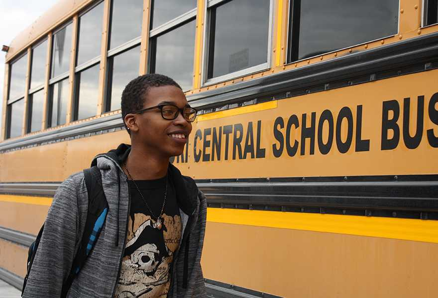 Freshman Chris Bass prepares to board his afternoon bus for a 40 minute trip to his home in St. Louis city.