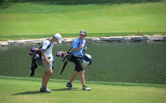 Senior Brian Ingberg walks to the next hole at Forest Hills Country Club for the varsity district tournament.