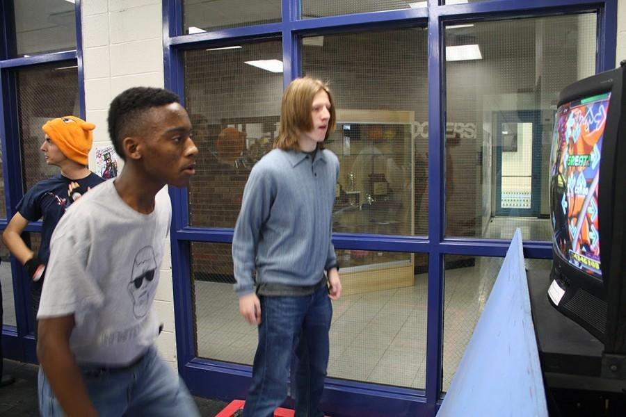 Junior Donte Hopkins and freshman Spencer Wells take each other on in a quick game of Dance Dance Revolution.