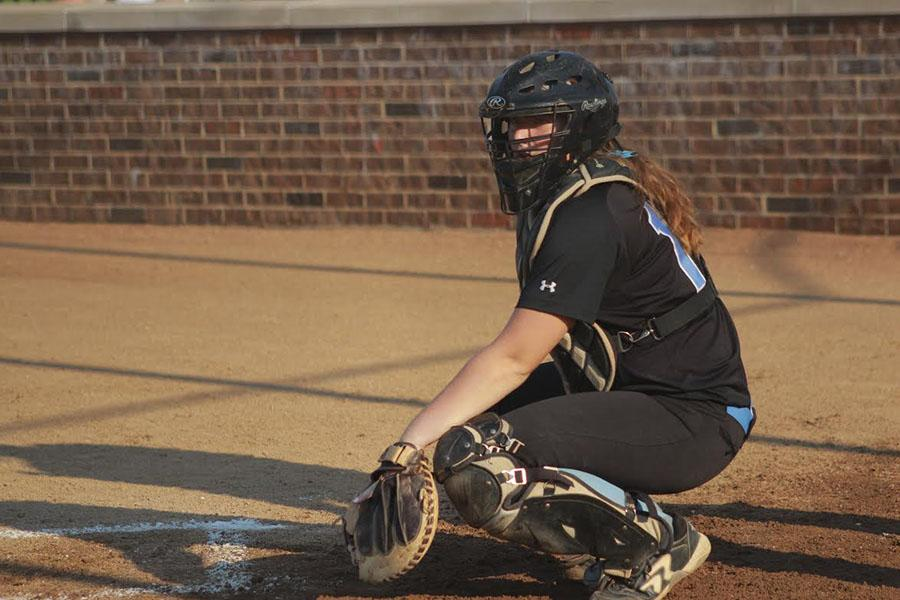 Junior Andrea Gordon plays catcher for the varsity girls softball team. The team was playing Webster Groves.