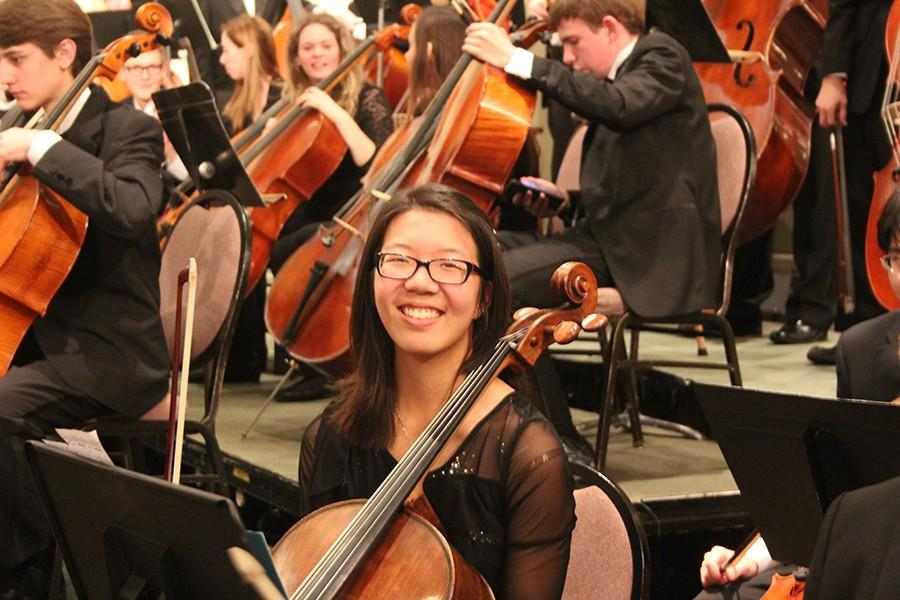 Junior+Rebecca+Su+sits+with+the+All-State+Orchestra+ensemble+prior+to+their+performance+at+the+Missouri+Music+Educator%27s+Association+Conference.