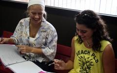 Senior Taylor Scott and freshman Caroline Shaw show off their spirit with tropical attire.