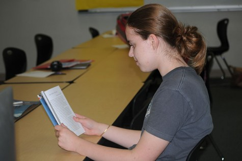 Freshman Sydney Kinzy reads her published story.