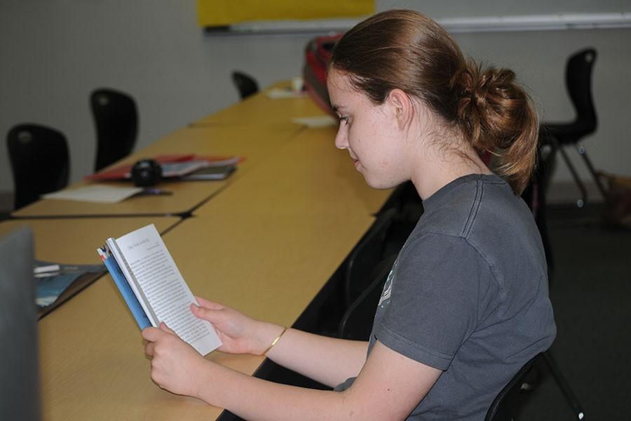 Freshman Sydney Kinzy reads her published story.